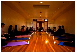 Blue Water Yoga with mats on the floor and candles