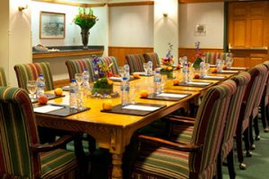 Meetings and Groups, Mezzanine room with a conference table with plush padded chairs around a table.