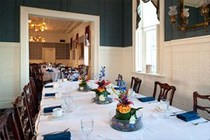 Meetings and Groups, Victorian Private Dining room with a table and plush padded chairs around it. Seats 12.