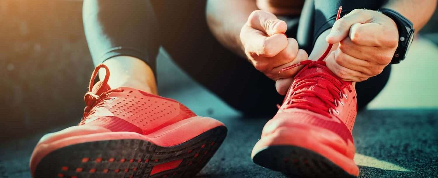 Person Tying Athletic Shoes before a Run