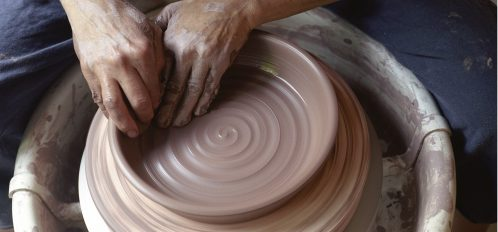 potter working clay on a potters wheel