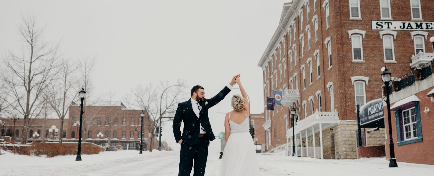 Married couple dancing in the snow